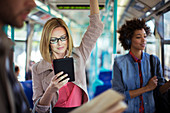 Businesswoman using tablet on train