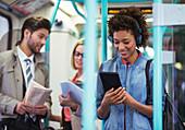 Woman using digital tablet on train