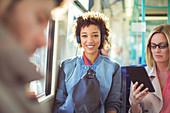 Woman listening to headphones on train