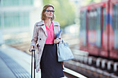 Businesswoman waiting at train station