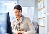 Female office worker sitting