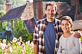 Father and son in flower garden
