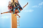 Friends bungee jumping at amusement park