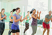 Students clapping in aerobics class