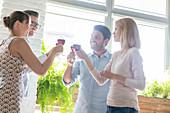 Friends toasting wine glasses