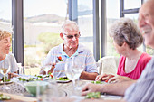 Senior couples enjoying patio lunch