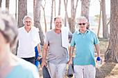 Senior men after yoga class in park