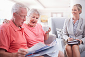 Financial advisor with senior couple