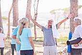 Exuberant senior man after yoga class