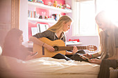 Girls playing guitar