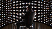 Man watching video on monitors