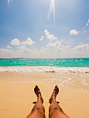 Man sunbathing on sunny tropical beach