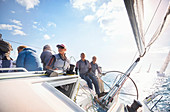 Retired friends on sailboat