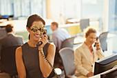 Businesswoman wearing dollar sign sunglasses