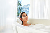 Woman relaxing enjoying bubble bath