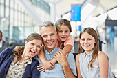 Portrait smiling family in airport departure area