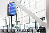 Arrival departure board in empty airport concourse