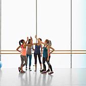 Women high fiving in gym studio