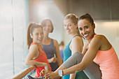 Portrait smiling women in gym studio