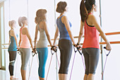 Women exercising at barre