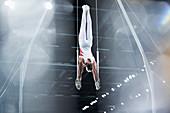 Male gymnast on gymnastics rings