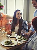 Waiter serving salads to women dining