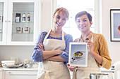 Portrait confident female caterers