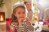 Portrait girl in Christmas paper crown