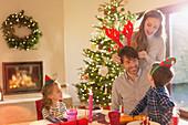 Family wearing elf and reindeer antlers