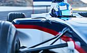 Formula one race car driver on sports track