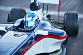 Formula one race car driver in helmet