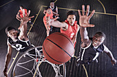 Overhead view basketball players jumping