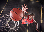 Overhead view basketball player jumping