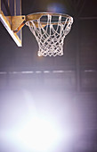 Lens flare around brightly lit basketball hoop