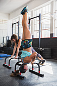 Young woman doing upside-down shoulder stand