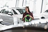 Female customer carrying hybrid charging cord