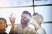 Entrepreneurs examining glass cube prototype