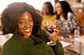 Portrait smiling young woman drinking red wine