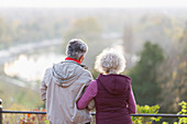 Active senior couple looking at view in nature