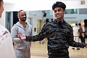 Confident, cool teenage boy in dance class studio