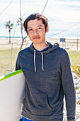 Portrait male surfer with surfboard