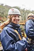 Portrait smiling, woman preparing to zip line