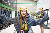 Portrait young woman preparing zip line equipment