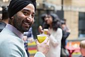 Portrait man in turban drinking, enjoying party