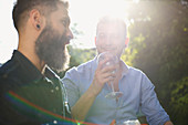 Male gay couple drinking wine and talking