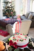 Decorated noel Christmas cake on sideboard