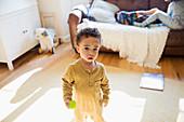 Portrait cute, innocent toddler boy in living room