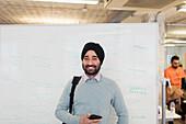 Portrait Indian businessman in turban standing