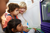 Curious kids using computer in science centre