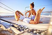Portrait woman relaxing on sunny catamaran